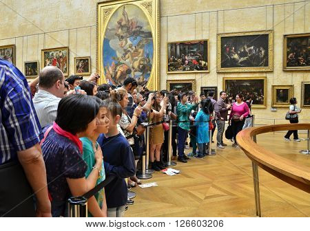 Paris France - May 13 2015: Visitors take photos of Leonardo DaVinci's
