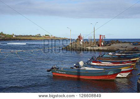 HANGA ROA, EASTER ISLAND, CHILE - APRIL 7, 2016: Fishing boats in a small harbour in HANGA ROA, capital of Easter Island.