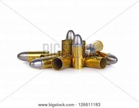a pile of bullets and bullet shells on a white background