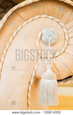 Beautiful tassel of orange sofa up close stock photo