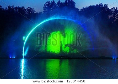 VINNYTSIA, UKRAINE - MAY 31, 2015: Biggest fountain on the river in Vinnytsia, Ukraine. Located in the river Southern Buh fountain has a length of 140 meters and the height of the jet up to 60 m ** Note: Soft Focus at 100%, best at smaller sizes