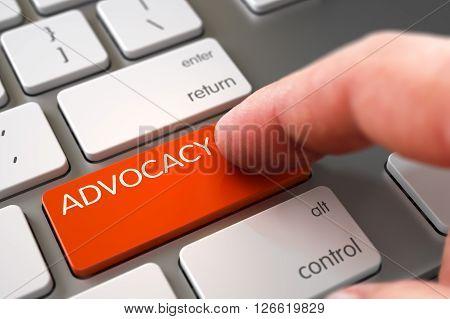 Finger Pushing Advocacy Key on Modernized Keyboard. Hand using Aluminum Keyboard with Advocacy Orange Button, Finger, Laptop. Advocacy Concept - Slim Aluminum Keyboard with Advocacy Button. 3D Render.