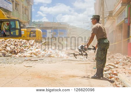 Portoviejo, Ecuador - April, 18, 2016: Drone operated by army to search for survivors after 7.8 earthquake in city center.