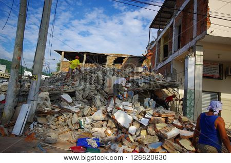 Portoviejo, Ecuador - April, 18, 2016: Mountain of rubble fro a collapsed building after 7.8 earthquake.