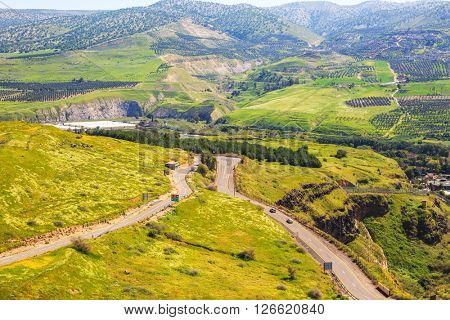 Hot springs Hamat Gader near the Israeli-Jordanian border. Serpentine road winds through the green hills