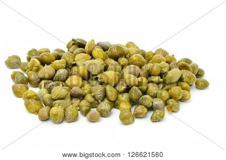 closeup of a pile of pickled capers on a white background