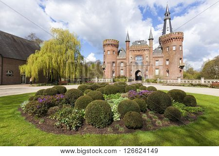 Bedburg-Hau, Germany - April 17, 2016: South front of Moyland castle in the district of Kleve, one of the most important neo-Gothic buildings in North Rhine-Westphalia