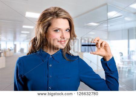 Smiling Girl Showing Bank Card