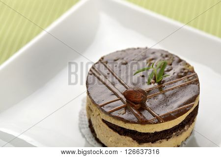 Chocolate cake decorated with hazelnut and rosemary