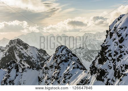 Mountain Peaks In The Tatra Mountains In The Morning In The Snow.