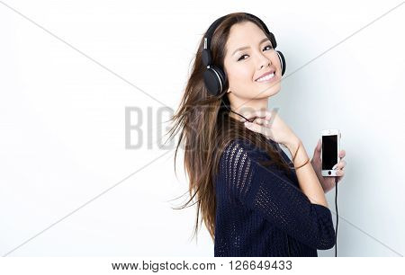 beautiful young asian woman listening to music with headphones
