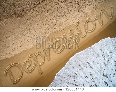 Depression written on the beach