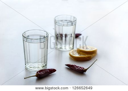 Cold Vodka In A Glass On A White Wooden Table