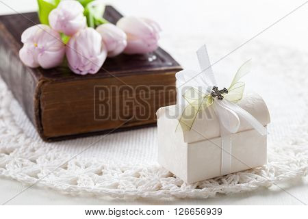 Small present with bible for the first holy communion