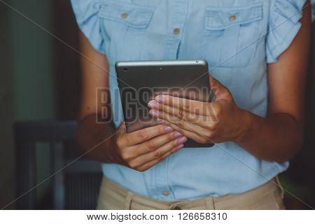 Businesswoman Holds Digital Tablet