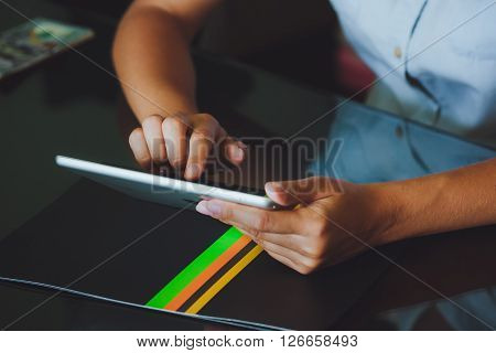 Woman Working On Digital Tablet