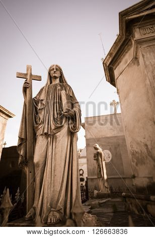 Angel and cross in recoleta cemetery in argentina