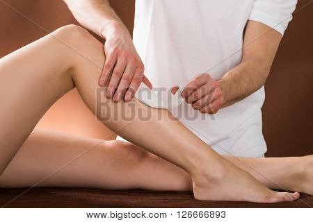 Woman Getting Her Leg Waxed