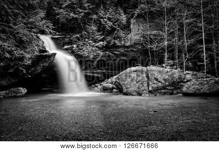 Lower Falls at Old Man's Cave in Hocking Hills Ohio in black and white. This is a very popular tourist attraction in Ohio.