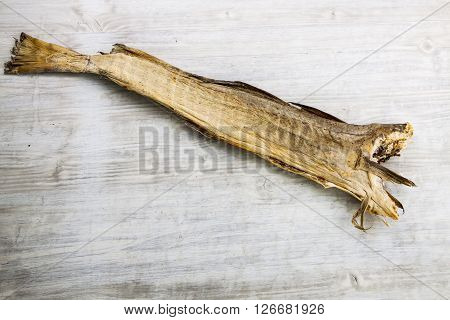 Dry Cod Fish On White Wooden Board