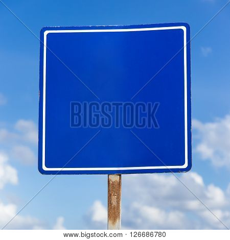 Empty Blue Road Sign At Tropical Street On  Sea Background
