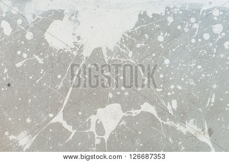 White splash on gray background concrete wall, messy, splotchy, surface. Decorative wet paint drops, abstract art
