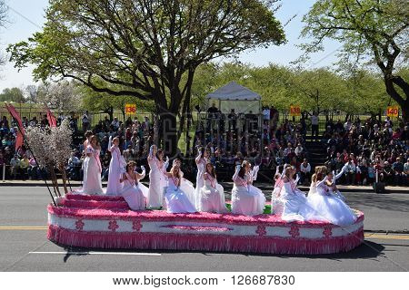 WASHINGTON, DC - APR 16: Cherry Blossom Queen float at the 2016 National Cherry Blossom Parade in Washington DC, as seen on April 16, 2016. Thousands of visitors gathered to attend this annual event.