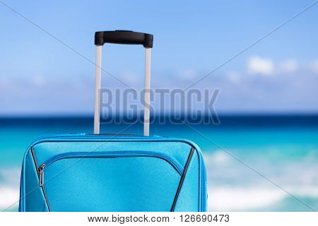 Blue Suitcase On Sandy Tropical Beach