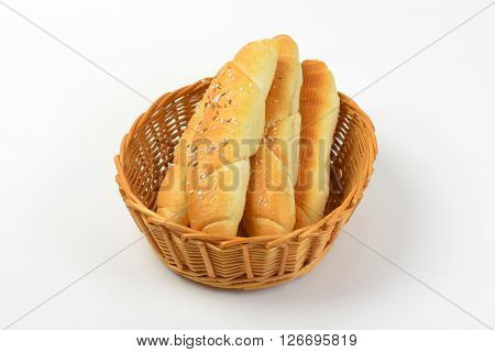 scuttle of fresh rolls with salt and caraway seeds on white background