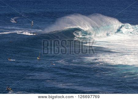 Surfer on wave at Peahi or Jaws surf break, Maui, Hawaii, USA