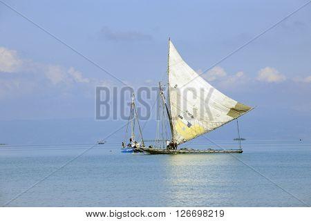 SAINTARD, HAITI - FEBRUARY 29, 2016:  Two large Haitian fishing sailboats in the Caribbean off the shore near Saintard, Haiti.