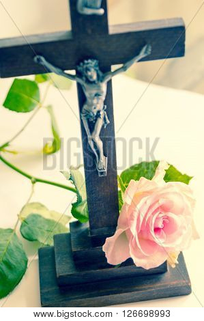 Jesus Christ on the Cross with pink rose