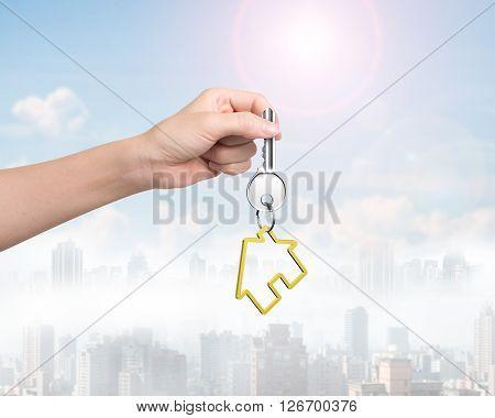 Woman Hand Holding Key With House Shape Keyring