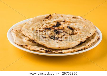 indian special bread also known as butter roti, chapati, naan, kulcha, paratha, tanduri roti
