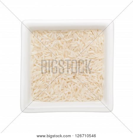 Long grain rice in a square bowl isolated on white background