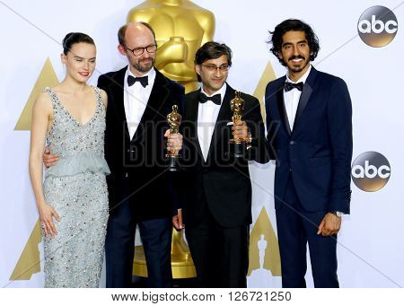 Dev Patel, Daisy Ridley, James Gay-Rees and Asif Kapadia at the 88th Annual Academy Awards - Press Room held at the Loews Hotel in Hollywood, USA on February 28, 2016.