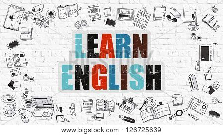 Learn English Concept. Multicolor Inscription on White Brick Wall with Doodle Icons Around. Modern Style Illustration with Doodle Design Icons. Learn English on White Brickwall Background.