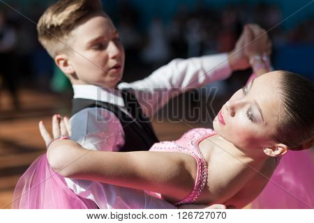 Minsk Belarus -April 3 2016: Pribylov Pavel and Maevskaya Marina Perform Youth-2 Standard Program on the IDSA Championship Kinezis Star Cup - 2016 in April 3 2016 in Minsk Republic of Belarus