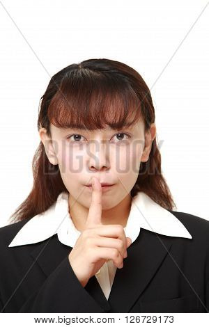Asian businesswoman whith silence gestures on white background