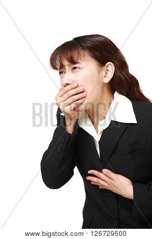 Asian businesswoman feels like vomiting on white background