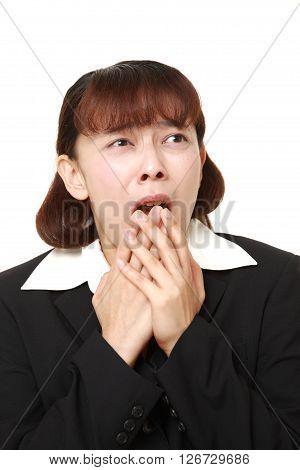 studio shot of businesswoman shocked on white background