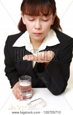 Asian businesswoman suffers from melancholy on white background