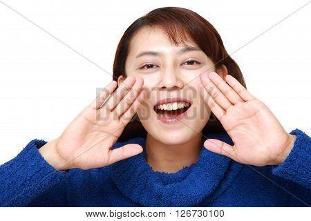 studio shot of Asian woman shout something on white background