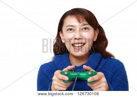 studio shot of Asian woman enjoying a video game on white background