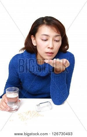 Asian woman suffers from melancholy on white background