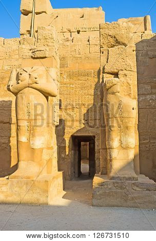 The tiny jib-door between the ruins of the large mummy statues in the Temple of Ramesses III in Karnak Complex Luxor Egypt.