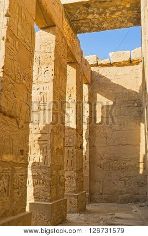 LUXOR EGYPT - OCTOBER 7 2014: The back side of the colonnade in Temple of Ramesses III decorated with the hieroglyphs and mythological reliefs Karnak Comlex  on October 7 in Luxor.