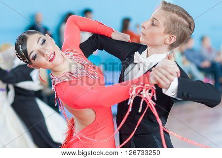 Minsk Belarus -April 3 2016: Kachura Ivan and Sirotko Anastasiya Perform Youth-2 Standard Program on the IDSA Championship Kinezis Star Cup - 2016 in April 3 2016 in Minsk Republic of Belarus