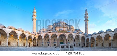 ISTANBUL TURKEY - JANUARY 21 2015:Panorama of the huge courtyard of the Suleymaniye Mosque with the ablution fountain located in the middle and two slender minarets on the background on January 21 in Istanbul.