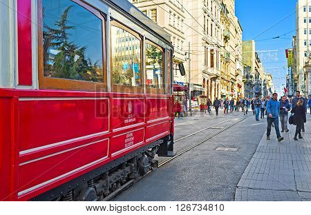 ISTANBUL TURKEY - JANUARY 22 2015: The main transport in Independence Avenue is the retro tram of Nostalgia Tramway connecting the Taksim Square and Tunel on January 22 in Istanbul.